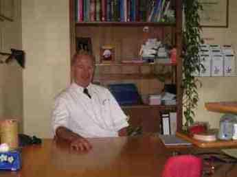 Dr Barrie Lewis DC at his desk in Heerlen, Netherlands.