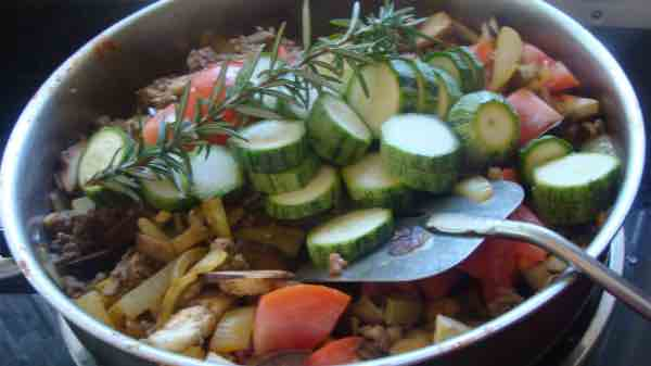 A photo of the bobotie vegetables in the pot.