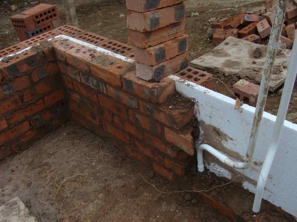 Brick wall insulation with polystyrene.