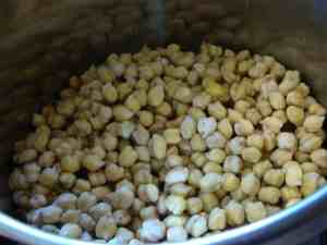 Cooking garbanzo beans, also known as chickpeas.