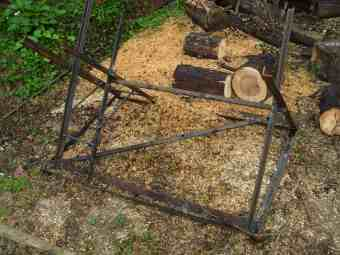 Firewood rack saves back and chainsaw