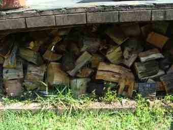 Split logs stacked for firewood.