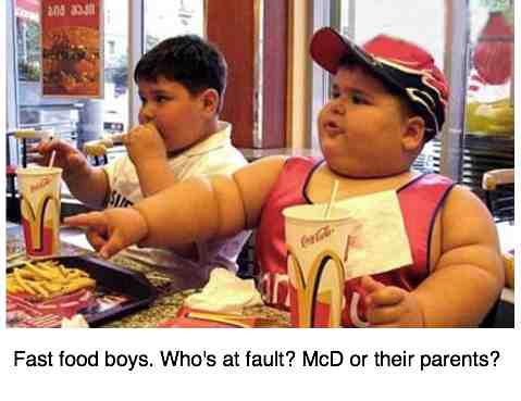 Fast food boys enjoying a meal very high in refined carbohydrate and cholesterol.