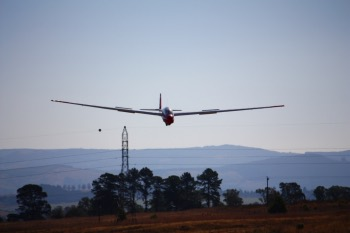 Bernie's glider landing after just clearing the high tension cables.