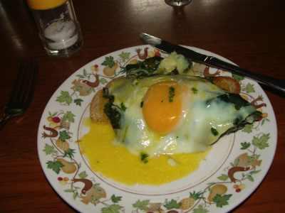 Hollandaise sauce on eggs Florentine.