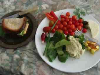 A honey sandwich on the side of salad including peppers with peppers makes for a delicious lunch.