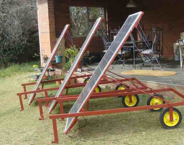 Three mobile solar carts to provide electricity for fluorescent light fittings.
