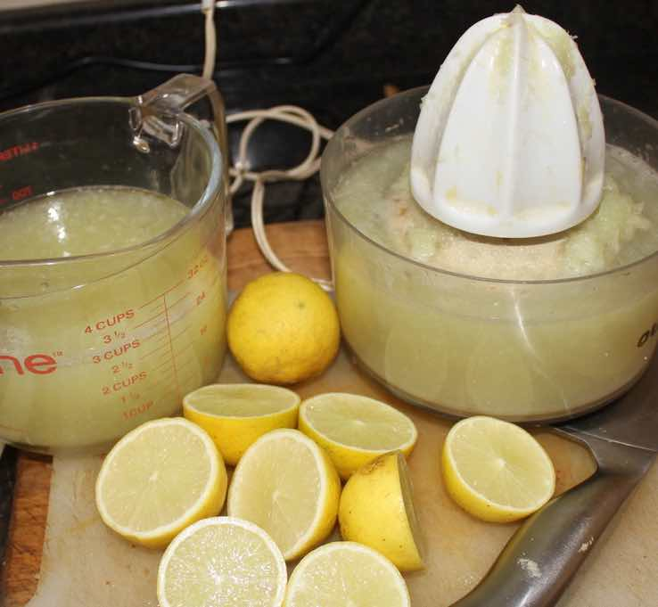 Pressing limes using an electric juicer.