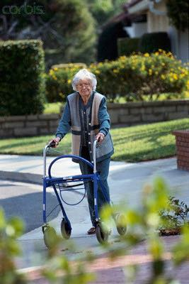 Woman with a walker showing why it's important to prevent frailty syndrome.