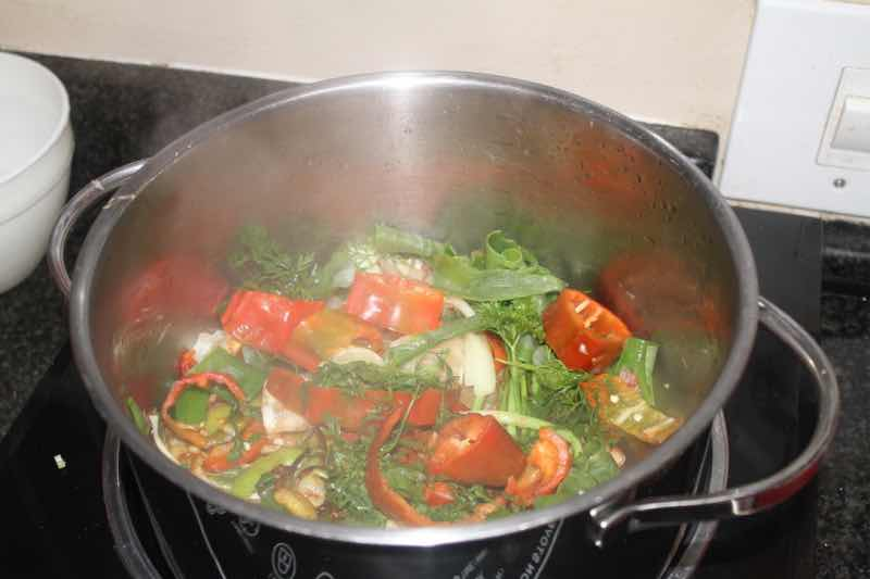Spicy Thai curry soup in pot.