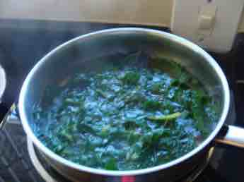 Swiss chard steaming in a pot.
