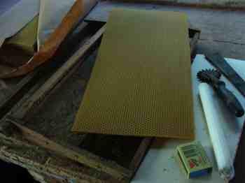 Waxing honeybee frames.