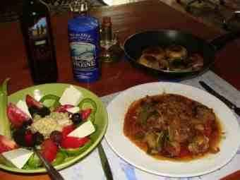 A mutton dinner with a Greek salad.