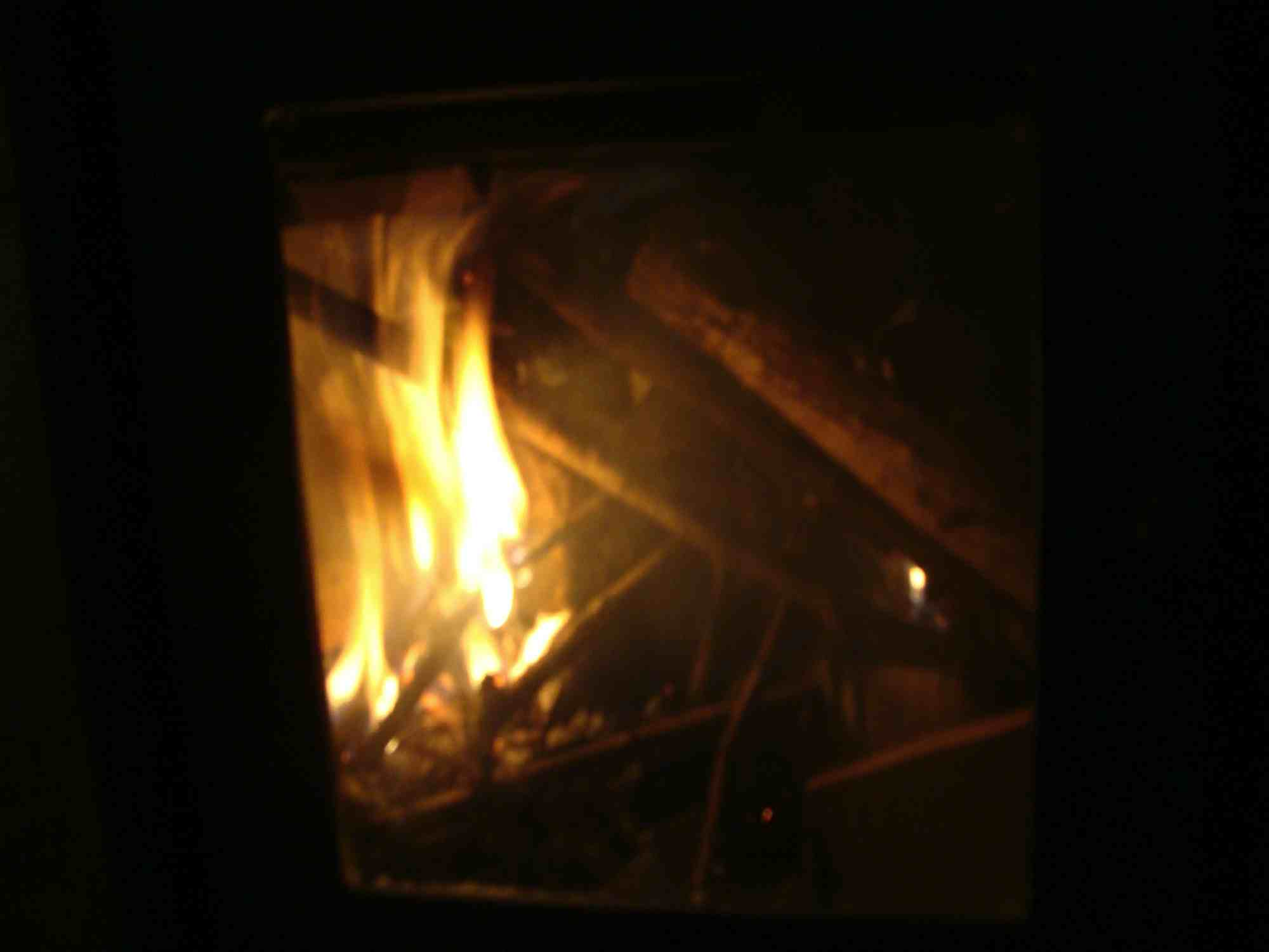The woodstove flames after 3 minutes.