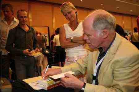 Bernard Preston signing books at a chiropractic conference in Vilamoura, Portugal.