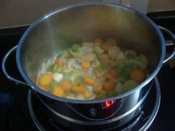 Borscht vegetables simmering in stock