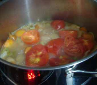 Borscht vegetables and tomatoes simmering