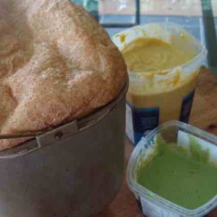 Bread and pesto with our authentic hummus recipe also shown.