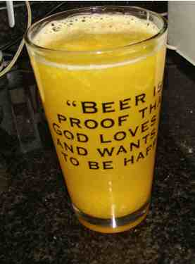 Orange juice in beer glass