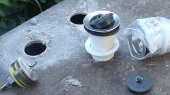 Use a hole saw to fit the waste plug