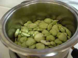 Lima beans about to be cooked in the pot.